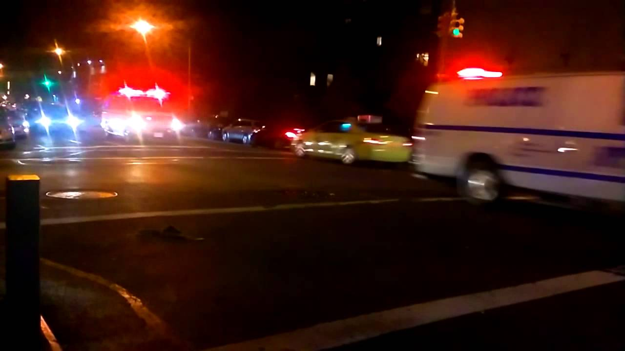 Two NYPD Arrest Wagons Transport Prisoners To Central Booking In East Harlem