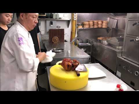 Chef Jian Chit Ming prepares his famous chicken at 2 Michelin star Canton 8 in Shanghai, China