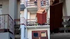 Movers Accidentally Drop Wardrobe off Balcony - 989808