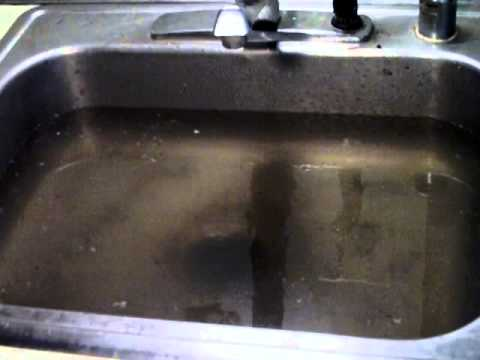 water from common drain backing up in kitchen sink