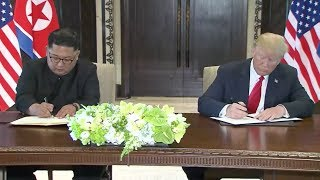 Trump and Kim sign a