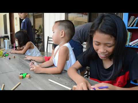 Slum kids make their own dice out of wood in Guadalupe, Cebu, Philippine Islands