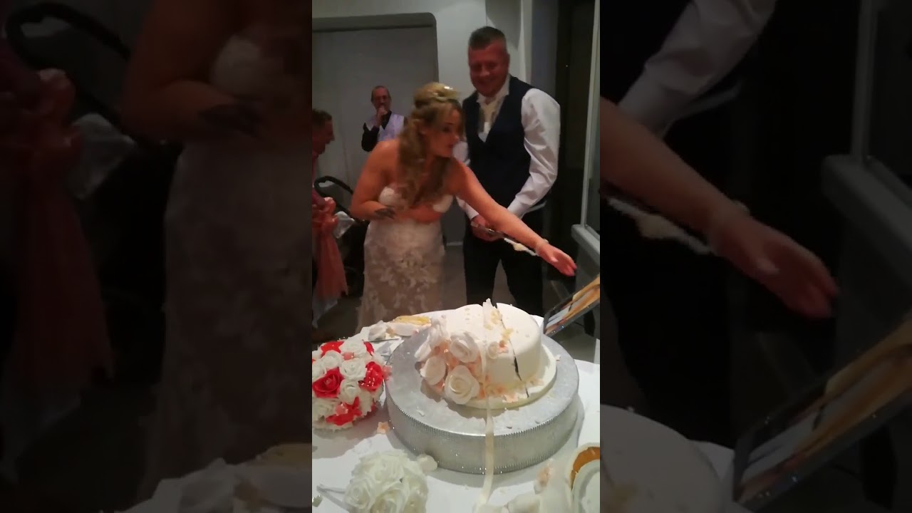 cutting wedding cake with sword lad gets carried away while cutting his wedding cake with 13304