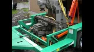 moving equipment with a lift deck trailer