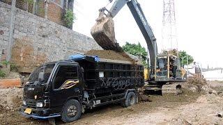 Excavator Digging Concrete Pile Loading Dump Truck Volvo EC210B