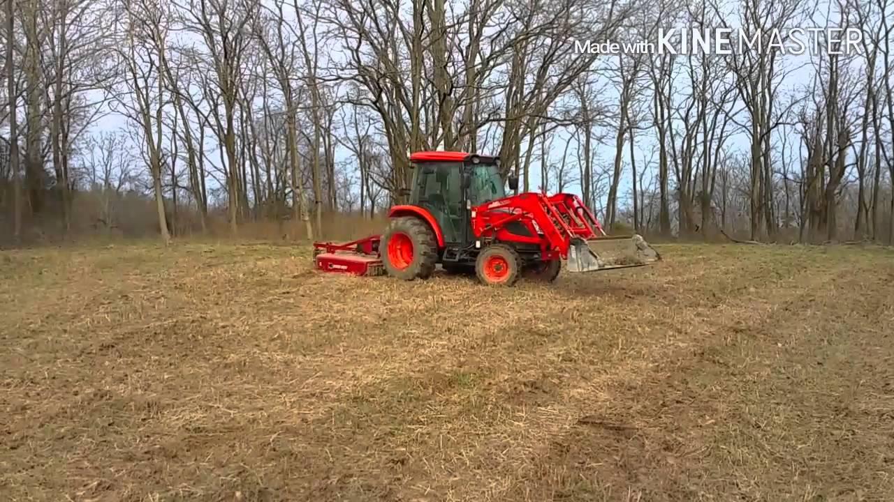 Cutting future food plot with Bush hog BH26 and Kioti 7 of 99