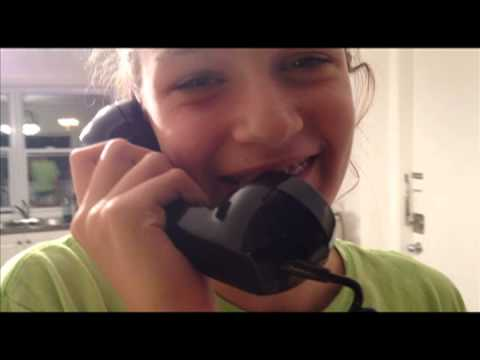 Two kids use a rotary phone for the first time