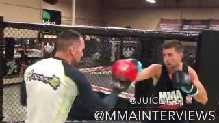 Zach Juusola works boxing mits with Spencer Lazara at Xtreme Couture