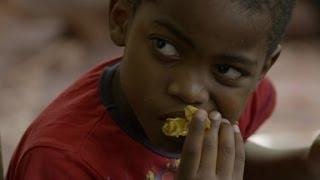 Bourdain learns how to eat Senegal's national dish