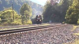 Fast moving NS freight train with echoing Nathan P5 horns.