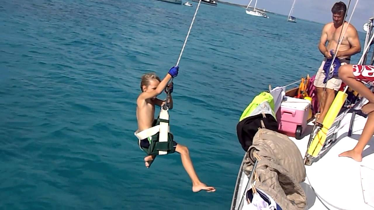 cole swinging on bosunu0027s chair from spinnaker halyard