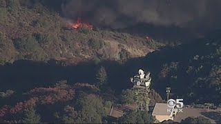KEY CELL TOWER THREATENED:  Firefighters battle to save a vital Cal Fire cell tower