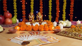 Pan shot of Hindu Gods Laxmi Ji and Ganesh Ji for Diwali puja - the festival of India
