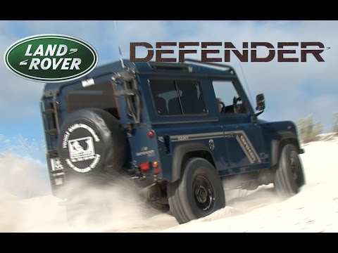 Land Rover Defenders and Toyota Hilux on the dune sands - 4x4 show