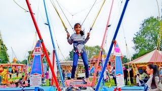 Kid Goes Bungee Jumping at The Carnival Fair Fun