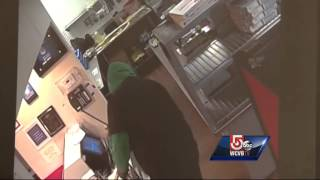 Robber uses pickaxe to hold up Quincy pizza shop