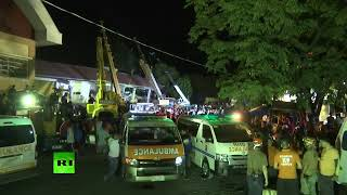 People trapped in collapsed building after strong quake hits Philippines