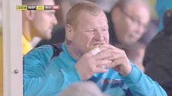 Wayne Shaw (Sutton United) taunts Arsenal with a pie