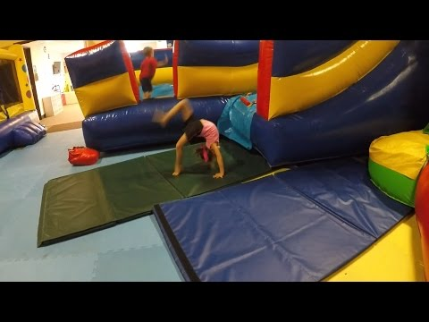 5 year old Brea at the Bounce House doing gymnastics