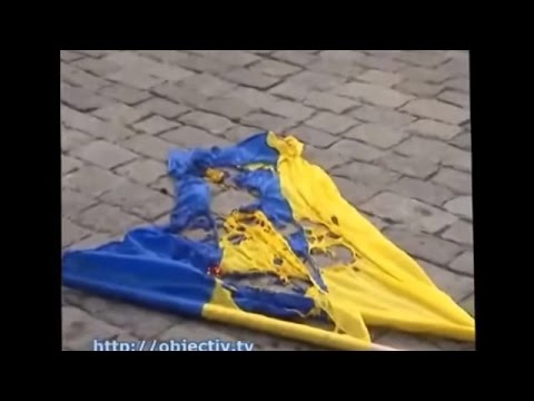 Ukraine War - Russian subversives burn Ukrainian flag and attack journalists in Kharkiv Ukraine
