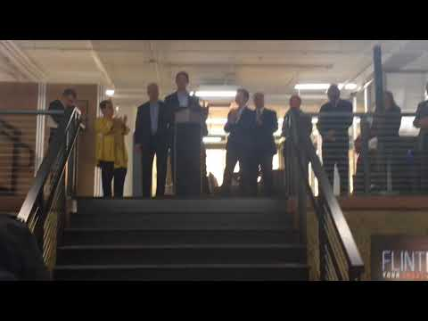 Gov. Rick Snyder cuts ribbon to Ferris Wheel building in downtown Flint