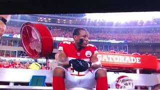 marcus peters sits during national anthem