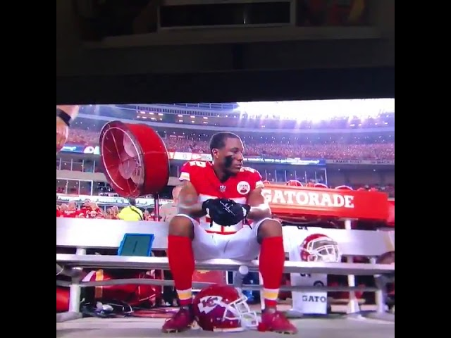 marcus-peters-sits-during-national-anthem