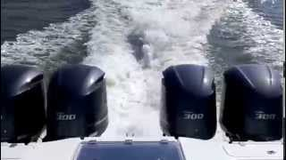 Freeman 37 with quad Yamaha 300 motors jumping up on plane