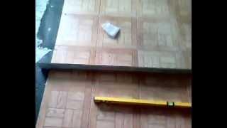 проверяем качество укладки напольной плитки