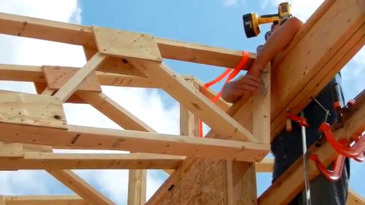 One man roof truss raising youtube Pre made roof trusses