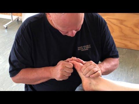 Foot reflexology massage using tools. Deep tissue foot massage. Brandon massaging Teresa in Tauranga