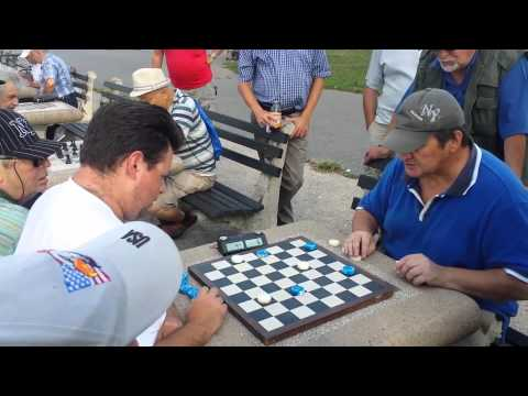 Aleksandr Golodiev vs. Mikhail Layevskiy playing 64 squares Checkers