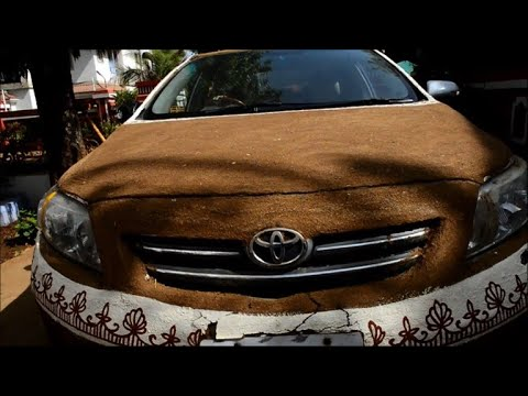 AFP news agency: Indian woman covers car in cow dung to avoid heat