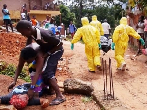 Ebola: Cemeteries Expand, Spain Nurse Released