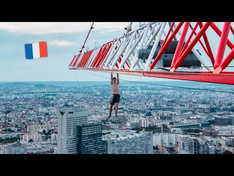The News Junkie - !8-Year-Old Man Dangles From Crane 600ft Above Paris