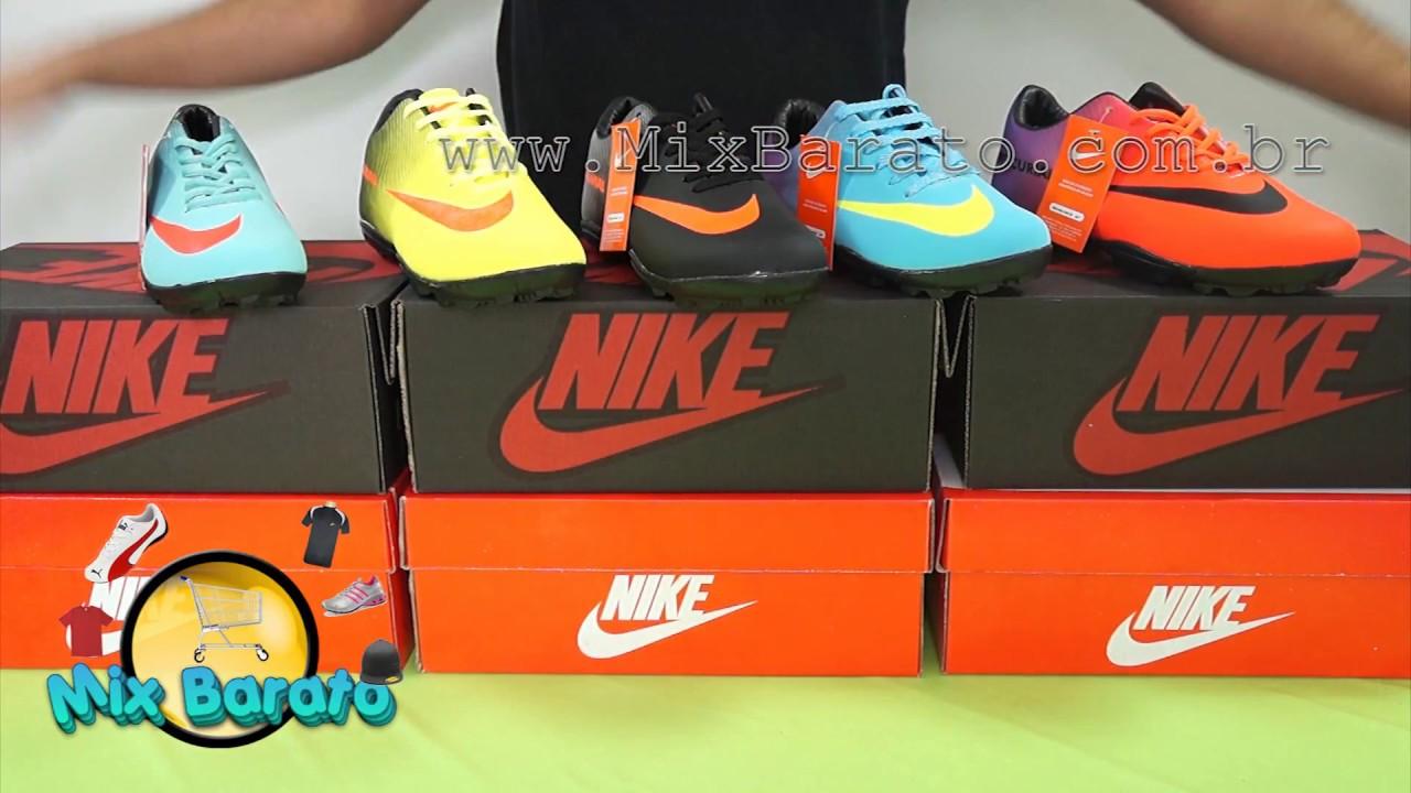 19a705a8cdb4b Chuteira Society Nike Mercurial Laranja e Roxa apenas R$99,90 (Importado) - Chuteiras  Nike Mercurial 11615 - Mix Barato