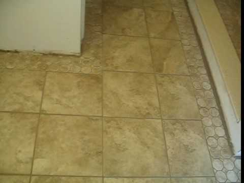 Ceramic Tile Shower Stall And Bathroom Floor With A Mosaic Border