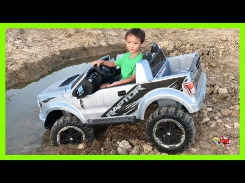 Kruz Joyriding His Power Wheel Ride On Ford Raptor STUCK In The Mud Towing Using His Dada's Rollback