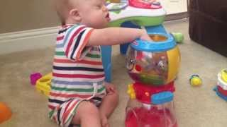Our Son With Down Syndrome Playing With A Fisher Price Gumball Machine