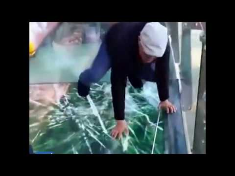 "Terrified tour guide freaks out after glass walkway ""cracks"" under his feet"