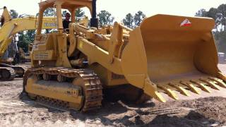 Caterpillar CAT Track Loader at Big Iron's Containerization Yard.MOV