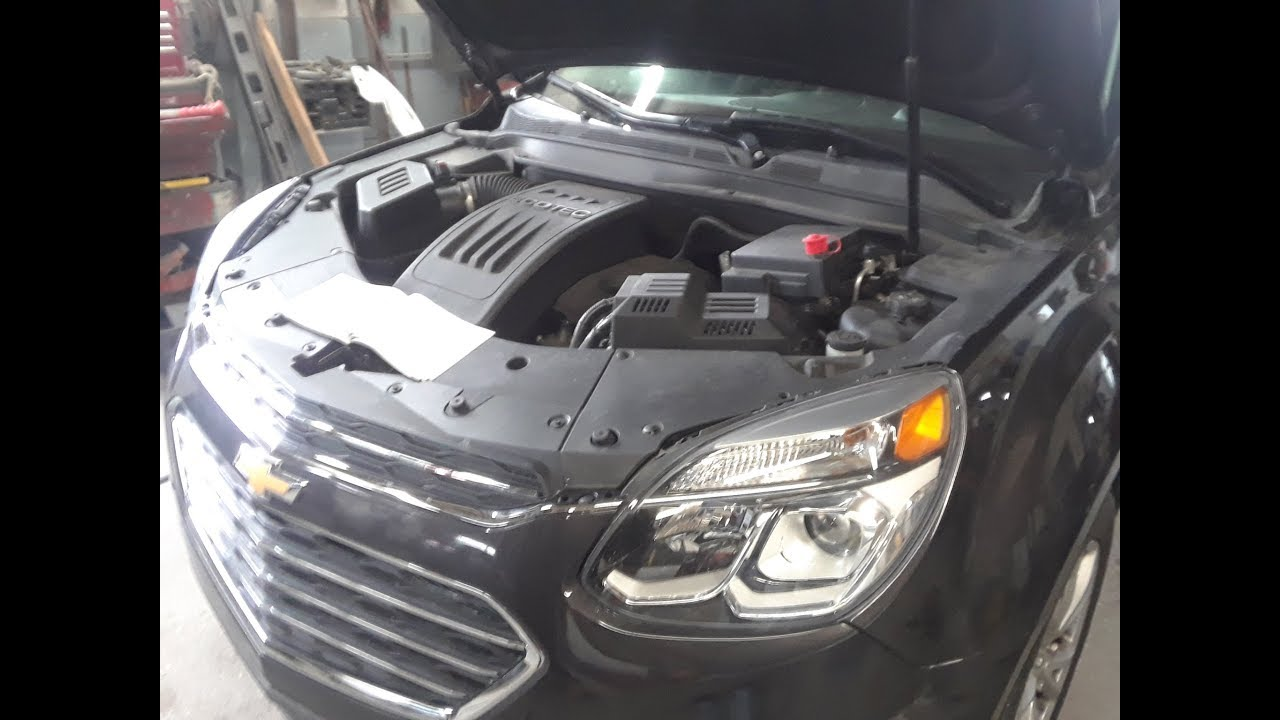 small resolution of chevy equinox battery location and how to jump hidden