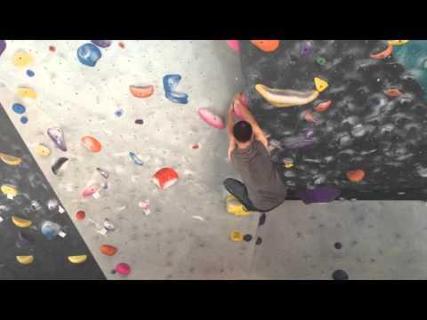 Climbing a dyno V5 at LA Boulders