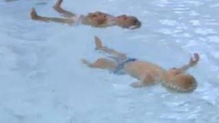 Nine month old UK twins show swimming skills