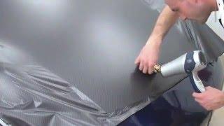 Wrapped Porsche. White PVC film and 2D carbon.