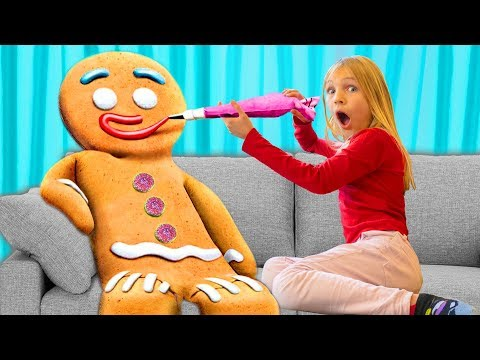 Amelia and Avelina party with a giant gingerbread man. Funny magic adventure!