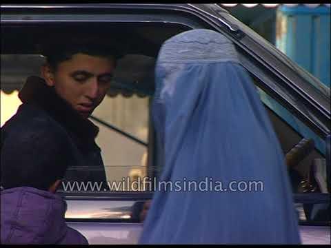 Burqa clad Afghan women beg in Kabul