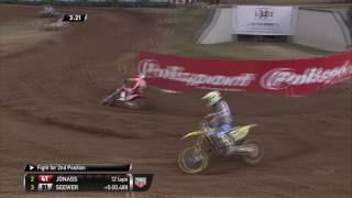 MXGP of Latvia Jeremy Seewer passes Pauls Jonass
