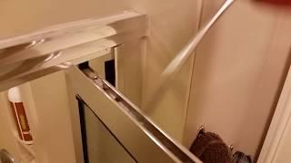 Shower door level adjustment