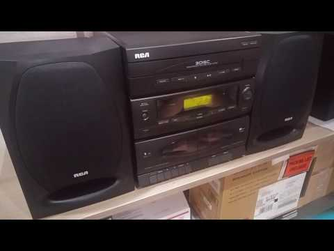 RCA Compact Stereo AM/FM, Dual Cassette Deck and 3-disc CD Changer. Model RP9316-A